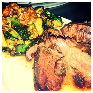 Hangar steak and pan roasted brussel sprouts with candied walnuts and bacon